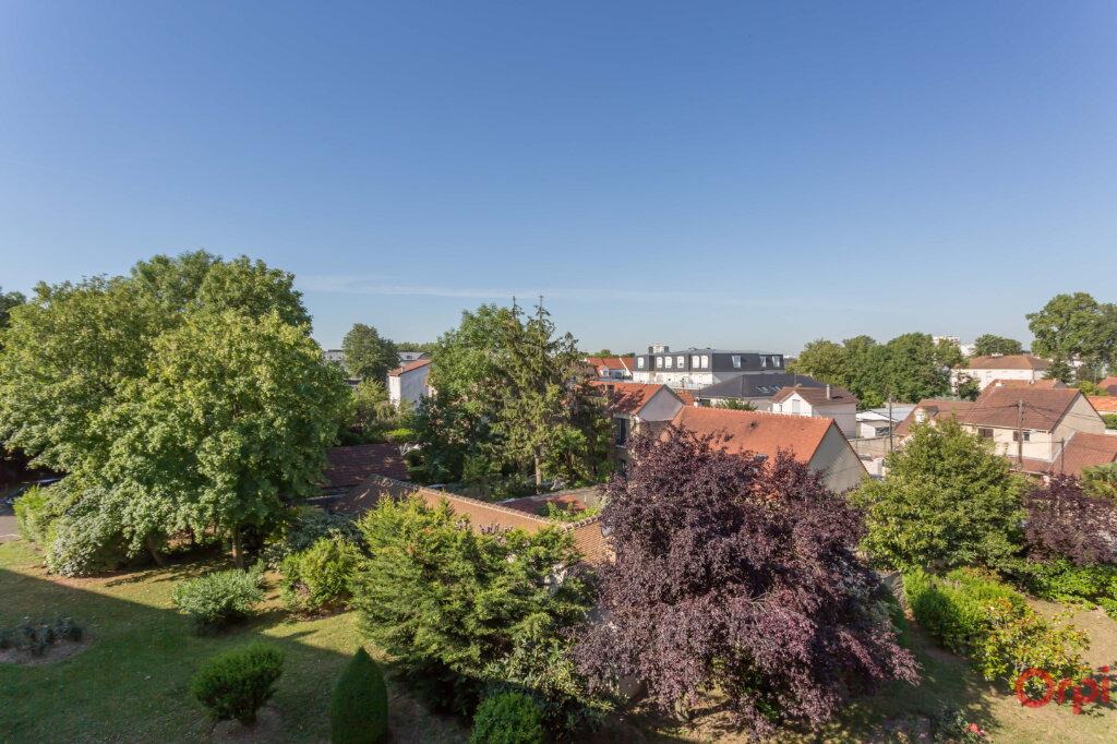 Appartement à vendre 4 80m2 à Sainte-Geneviève-des-Bois vignette-7