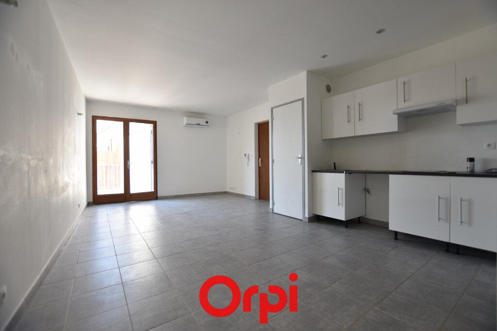Appartement à vendre 3 55m2 à Calvisson vignette-2