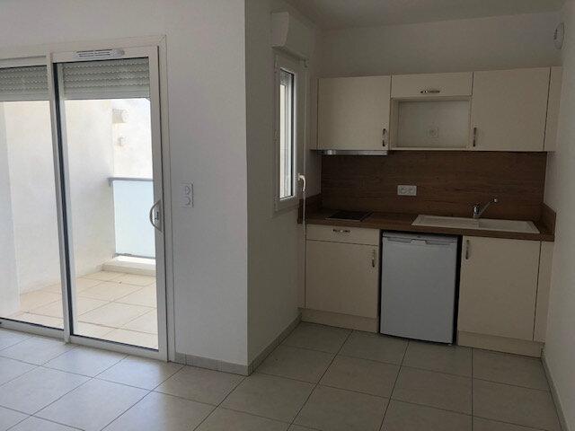Appartement à louer 1 25.95m2 à Caissargues vignette-2