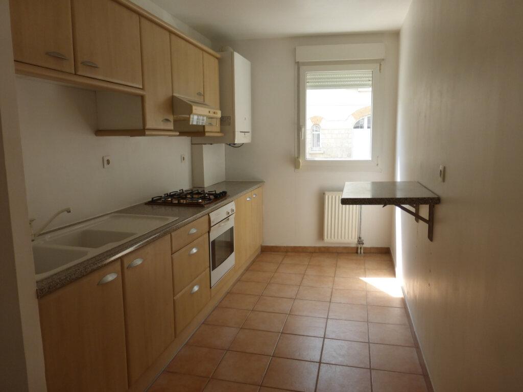 Appartement à louer 3 73.03m2 à Reims vignette-3