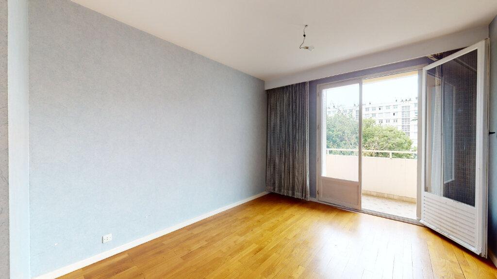 Appartement à vendre 7 146m2 à Villeurbanne vignette-4