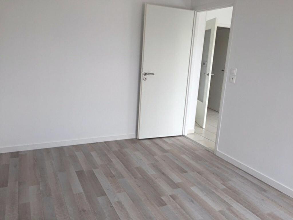 Appartement à louer 2 47.9m2 à Reims vignette-1