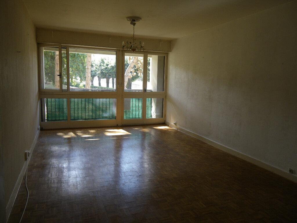 Appartement à vendre 5 99.35m2 à Reims vignette-2