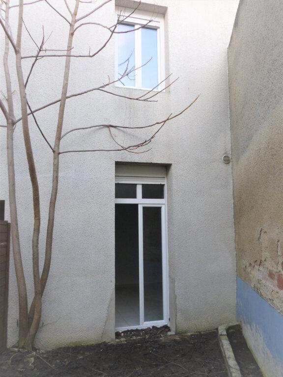 Appartement à louer 2 33.75m2 à Reims vignette-2