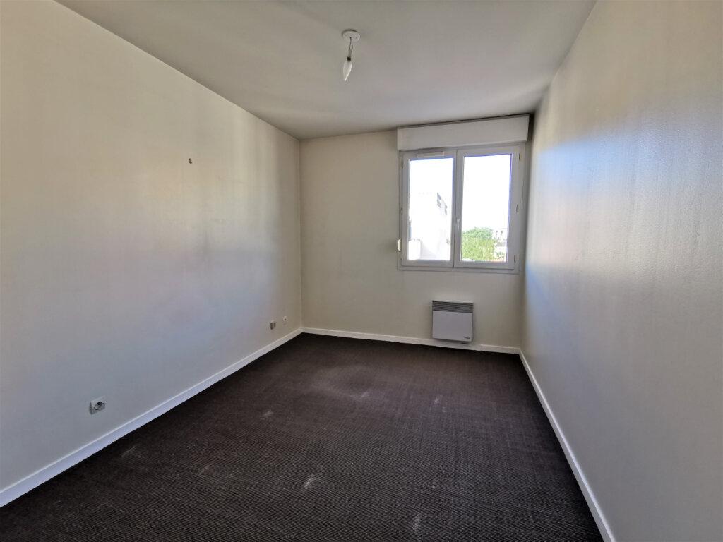 Appartement à louer 5 110.62m2 à Reims vignette-18