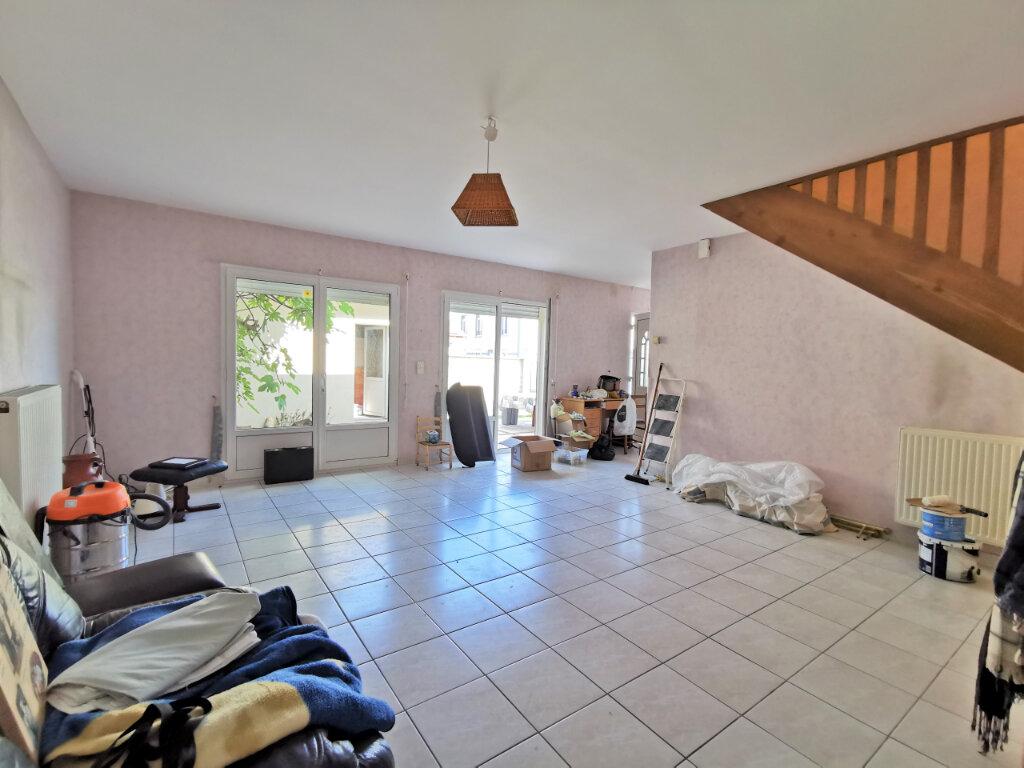 Maison à louer 5 131.74m2 à Reims vignette-5
