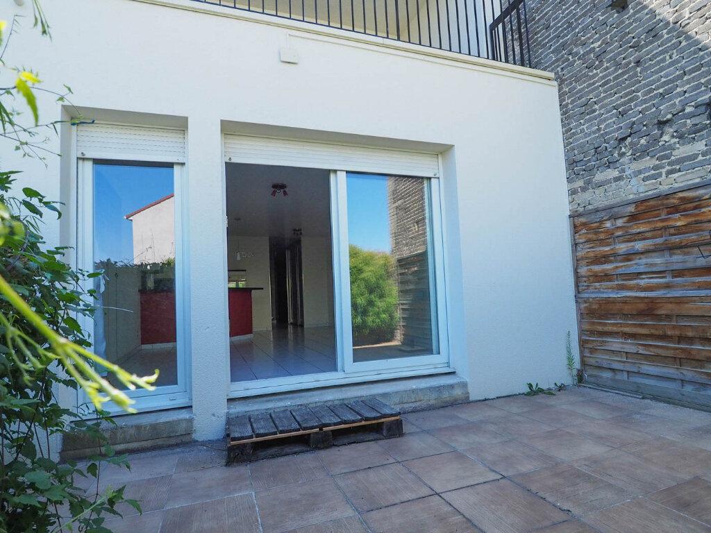 Appartement à vendre 4 68m2 à Reims vignette-1