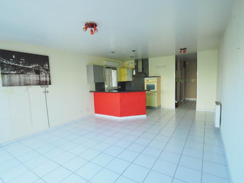 Appartement à vendre 4 68m2 à Reims vignette-3
