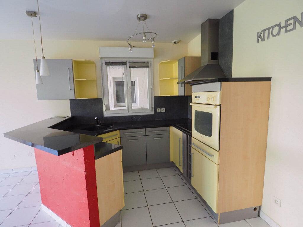 Appartement à vendre 4 68m2 à Reims vignette-4