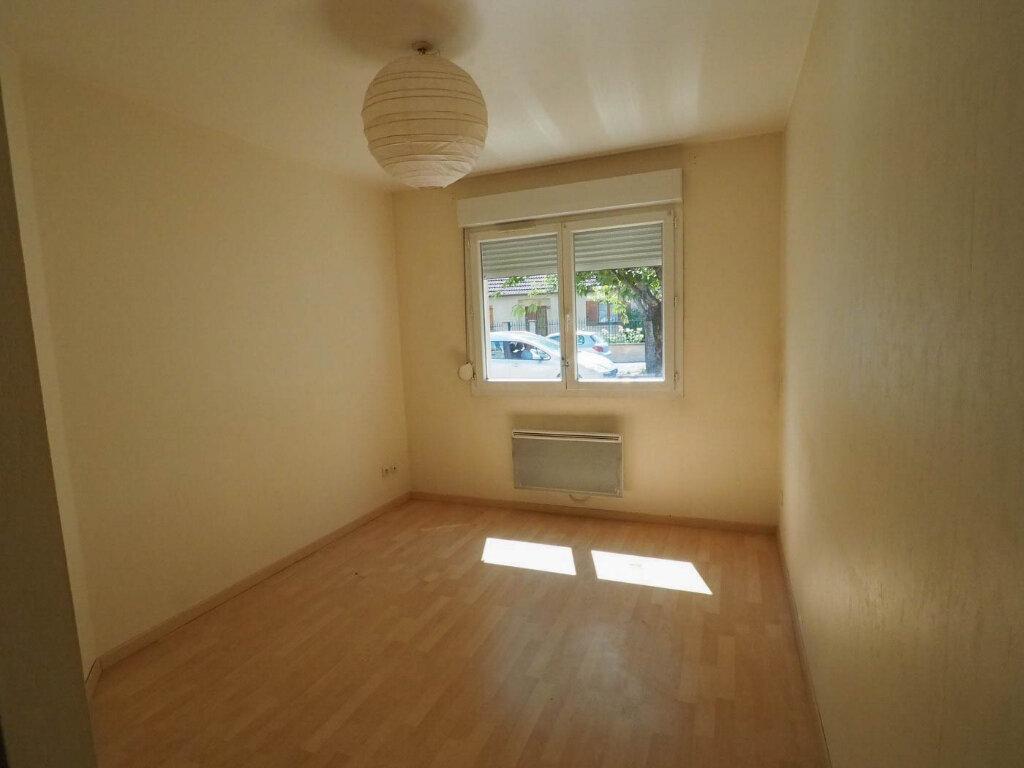 Appartement à vendre 4 68m2 à Reims vignette-6