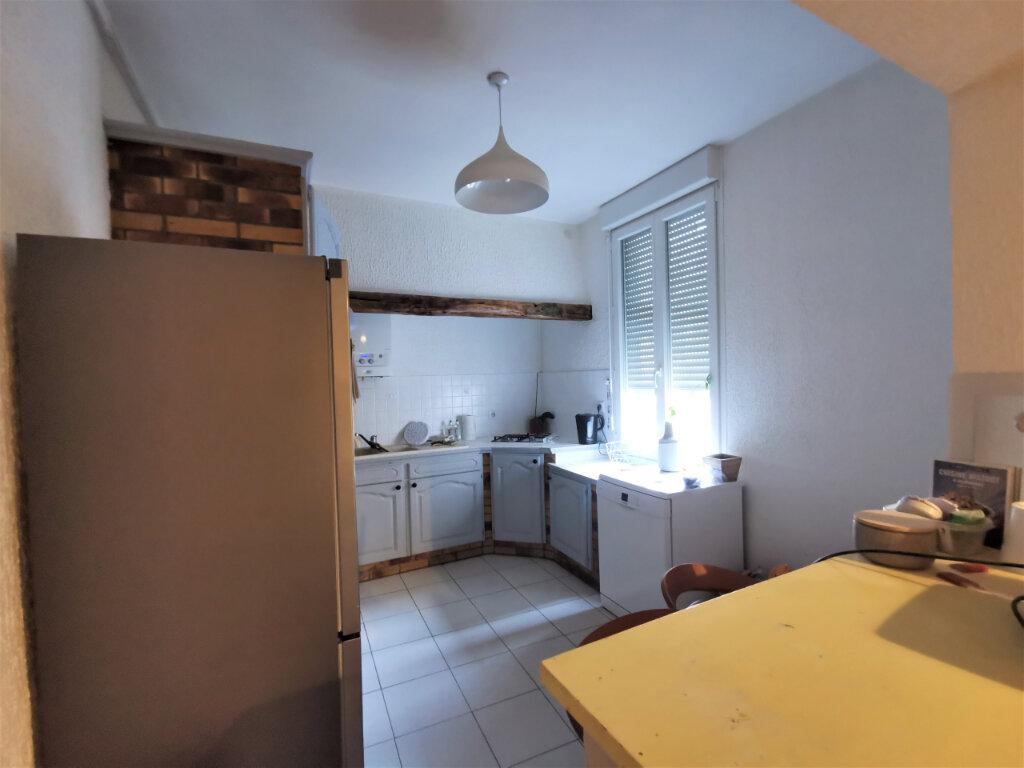 Appartement à louer 3 55.97m2 à Reims vignette-3