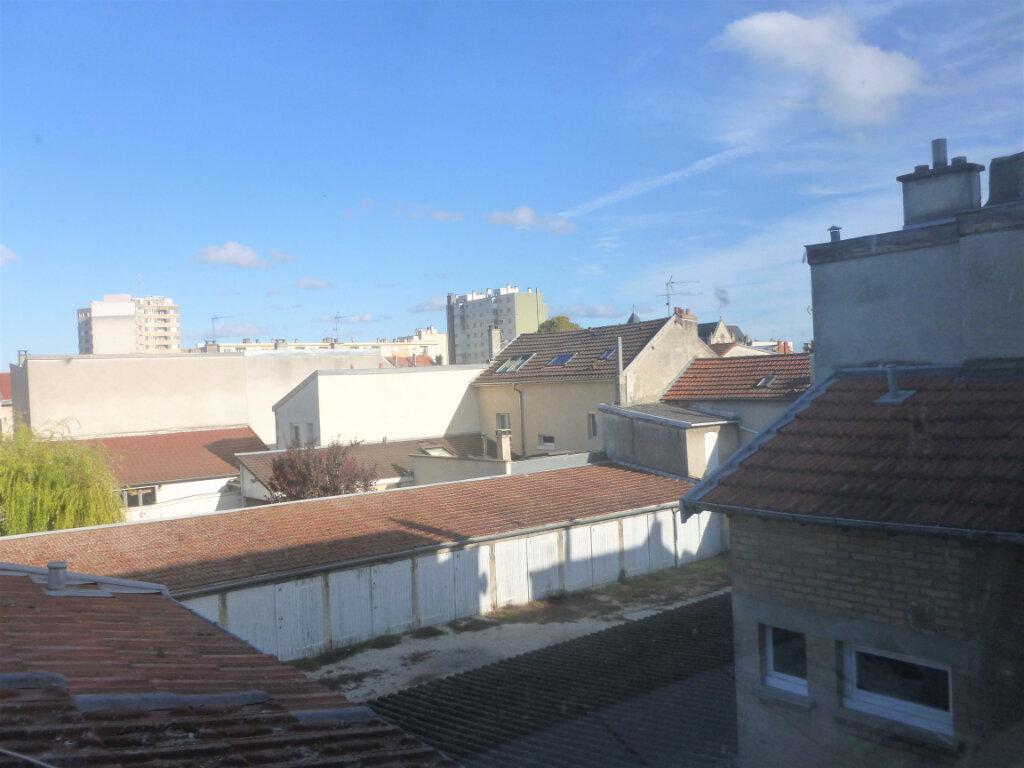 Appartement à louer 1 14.1m2 à Reims vignette-3
