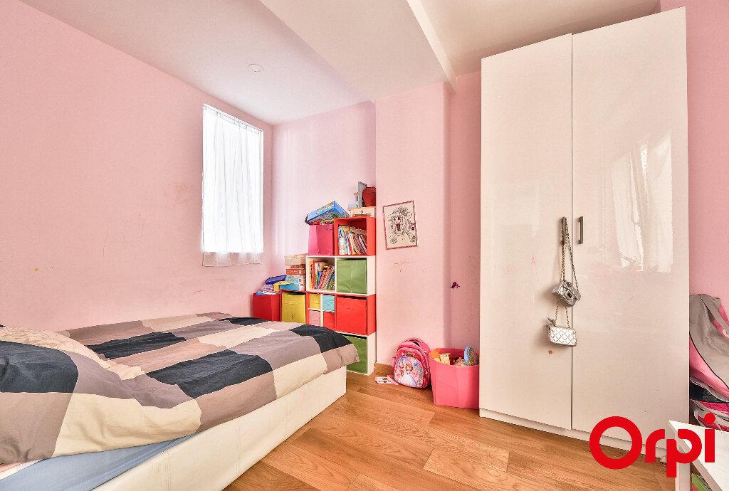 Appartement à vendre 4 91.5m2 à Paris 12 vignette-7