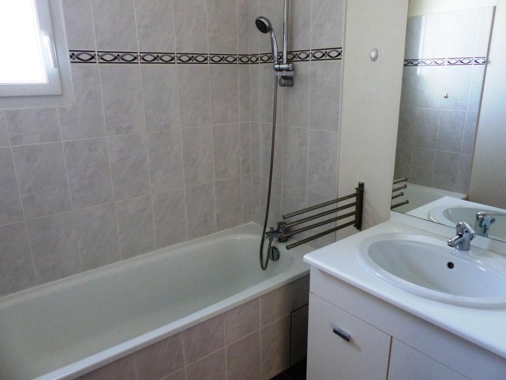 Appartement à vendre 3 66m2 à Sainte-Gemmes-sur-Loire vignette-4