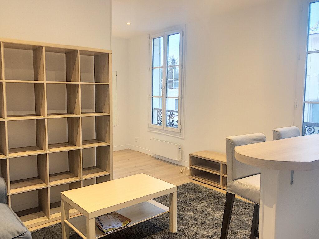Appartement à louer 1 28m2 à Paris 14 vignette-3