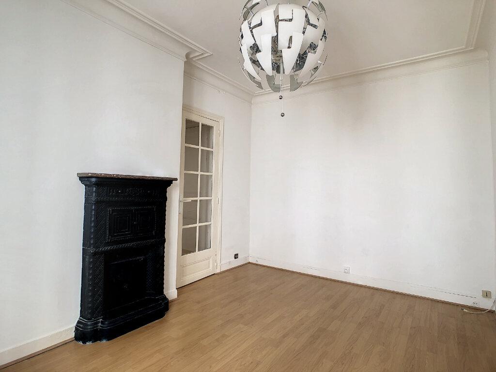 Appartement à louer 2 31.31m2 à Paris 14 vignette-2