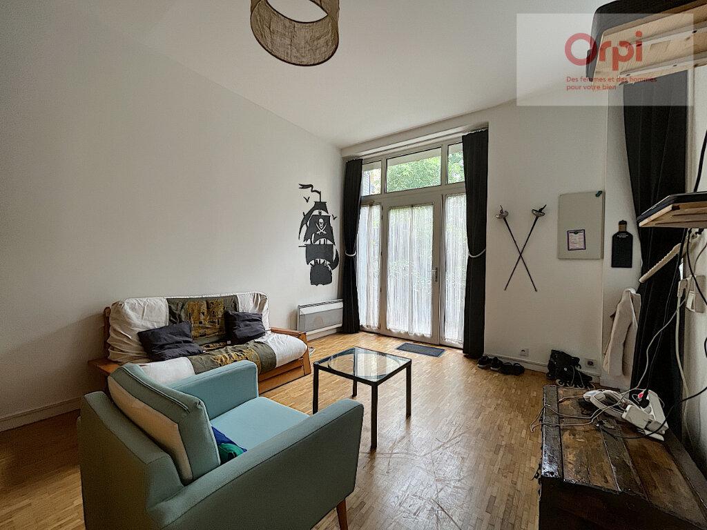 Appartement à louer 1 32m2 à Paris 14 vignette-3