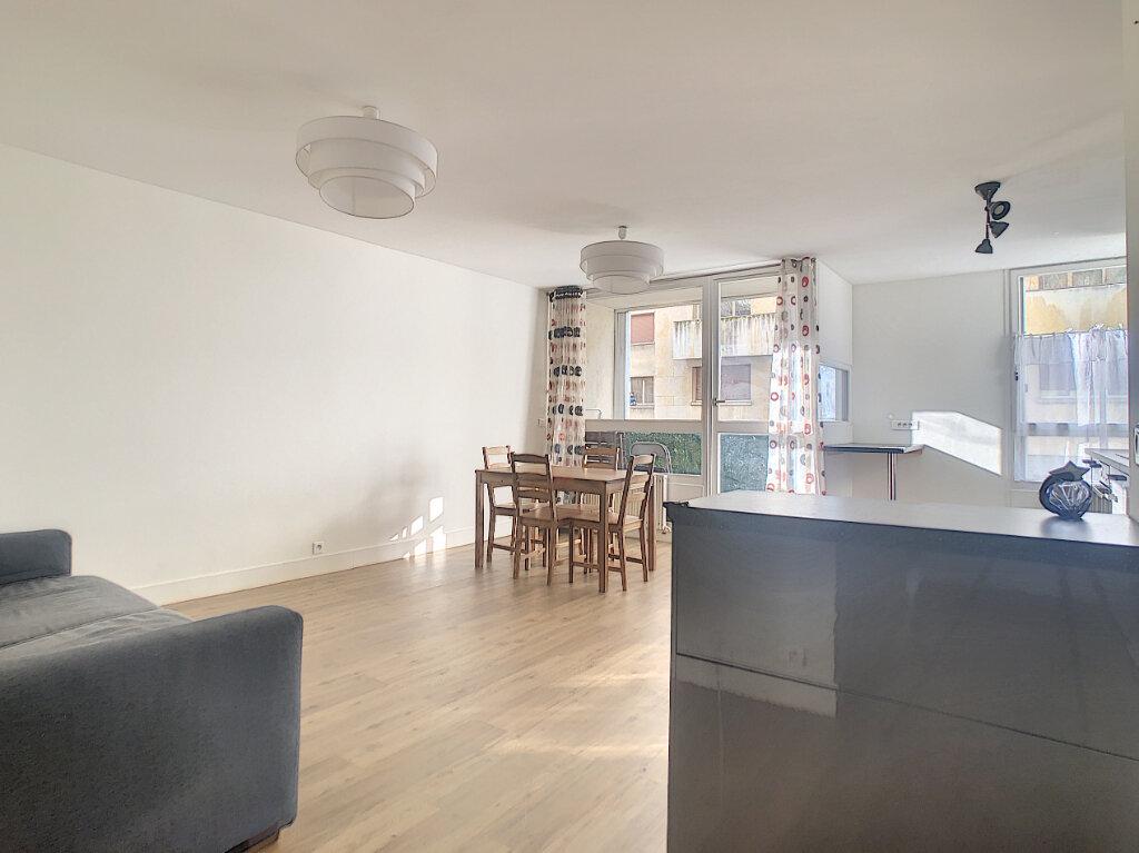 Appartement à louer 3 64.79m2 à Paris 14 vignette-1
