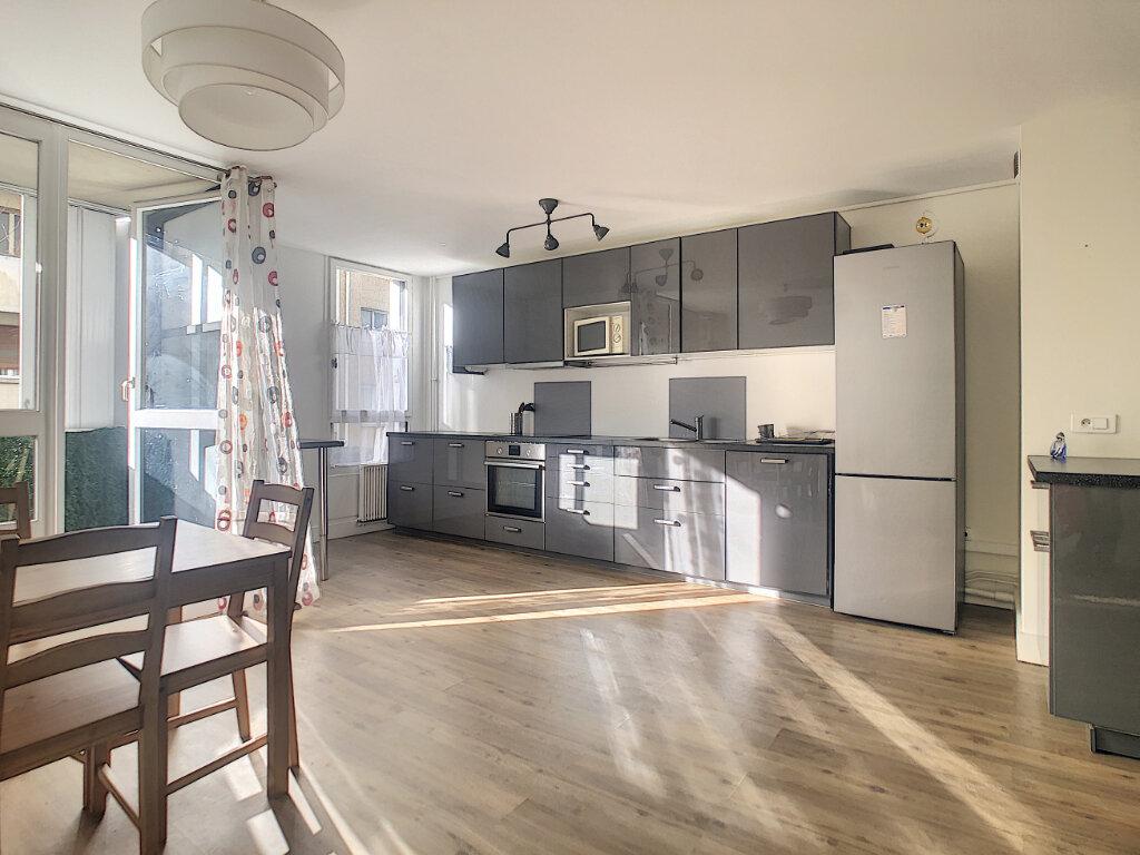 Appartement à louer 3 64.79m2 à Paris 14 vignette-2