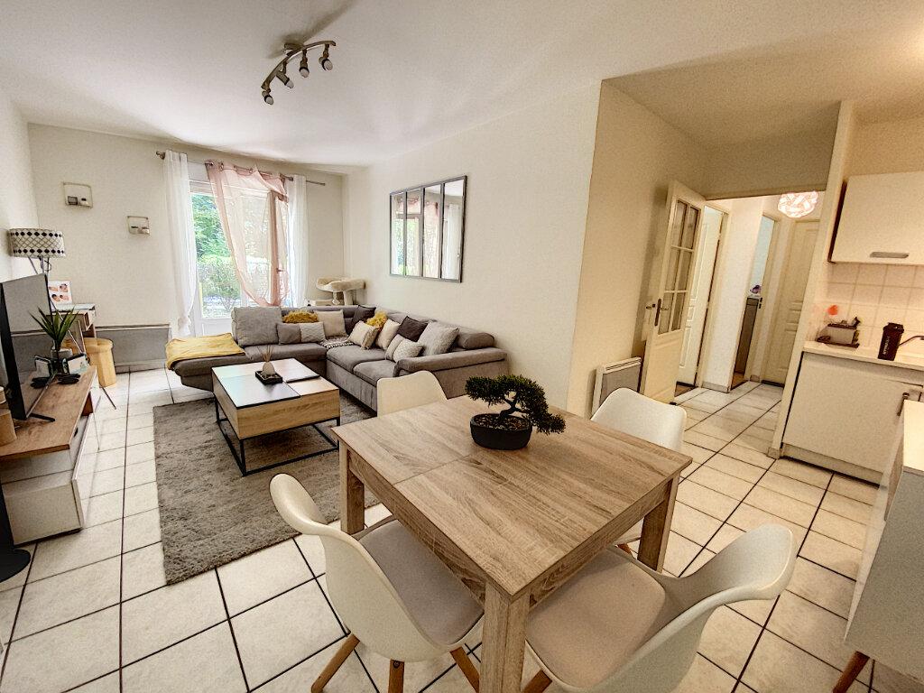 Appartement à louer 3 60.57m2 à Orléans vignette-2