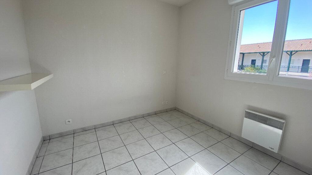Appartement à louer 3 59.64m2 à Saint-Vincent-de-Tyrosse vignette-6