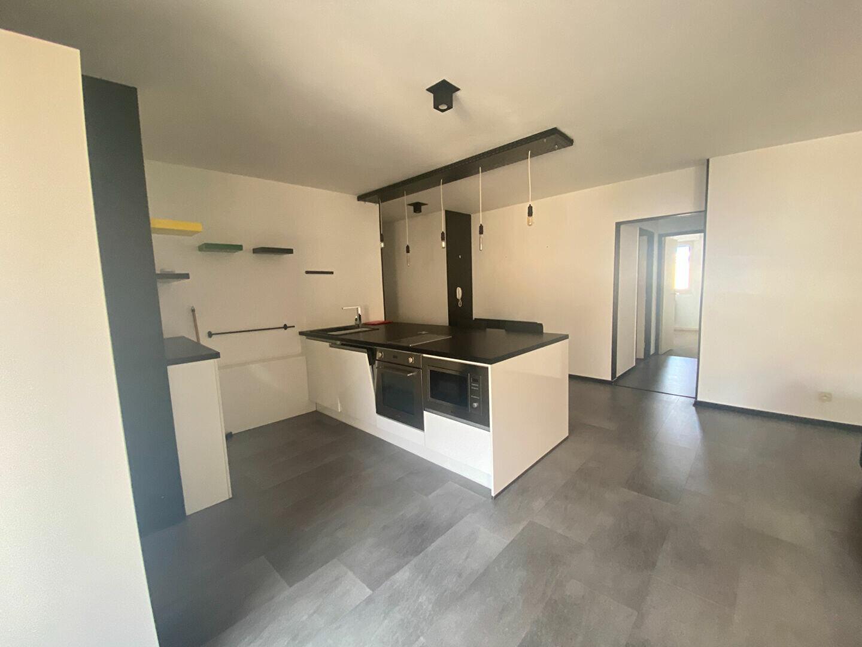 Appartement à louer 2 58.05m2 à Lyon 3 vignette-2