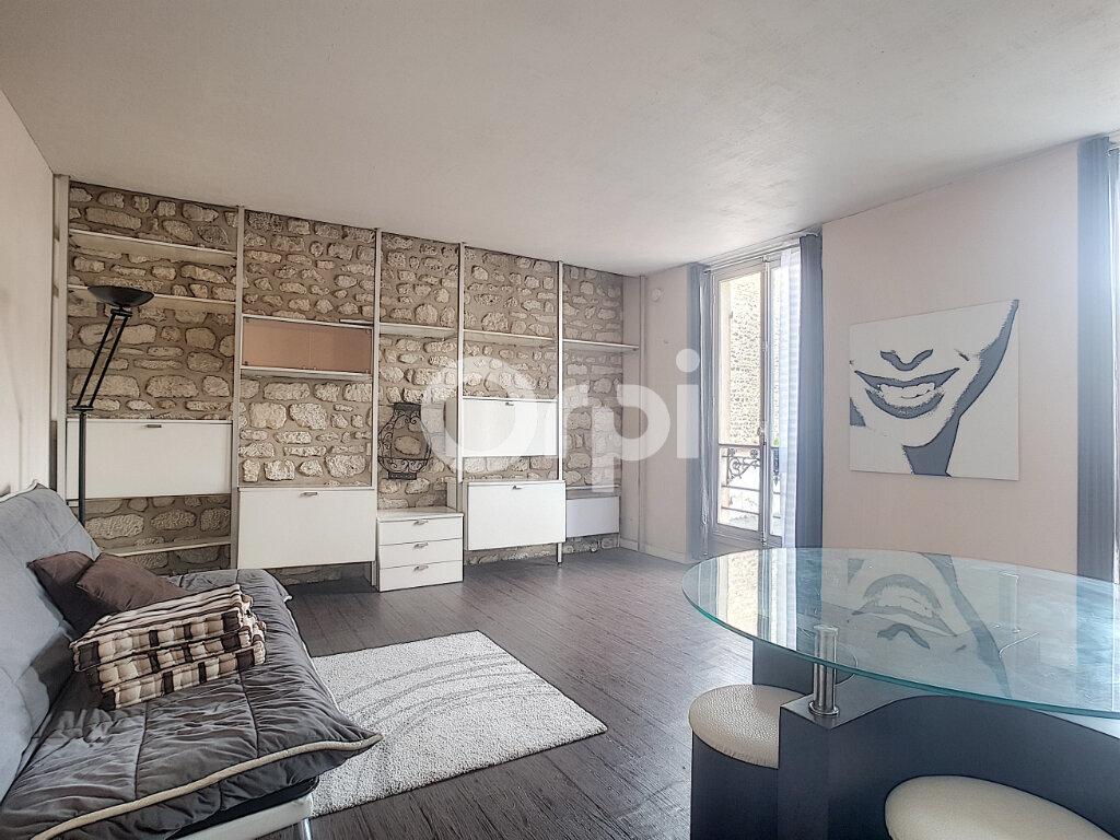 Appartement à louer 1 24.83m2 à Paris 14 vignette-1