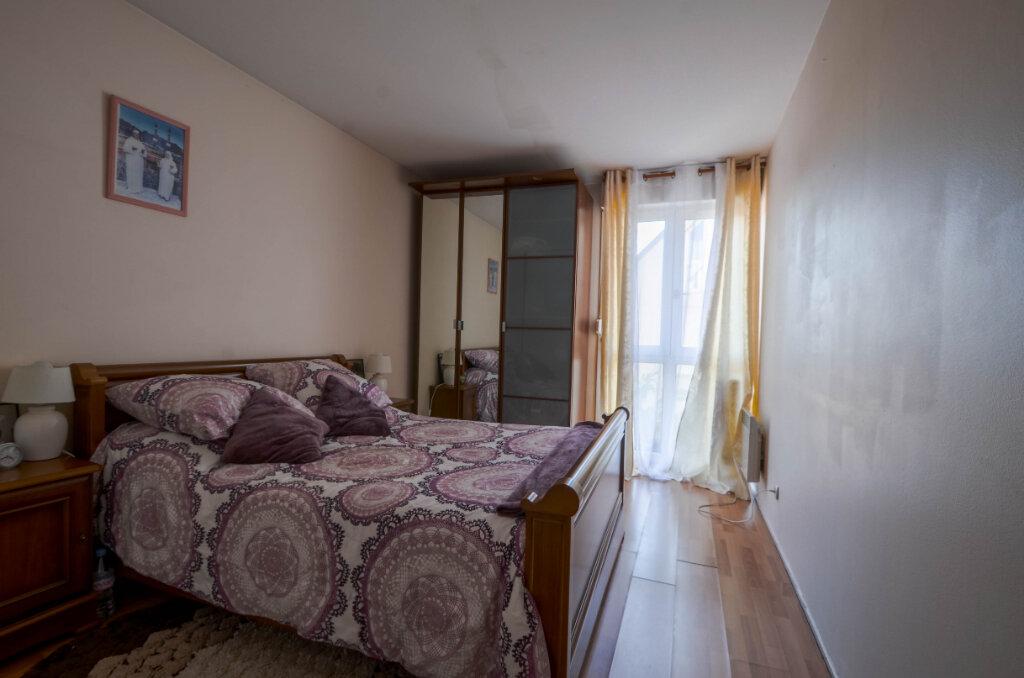 Appartement à vendre 3 68.56m2 à Saint-Ouen-l'Aumône vignette-4