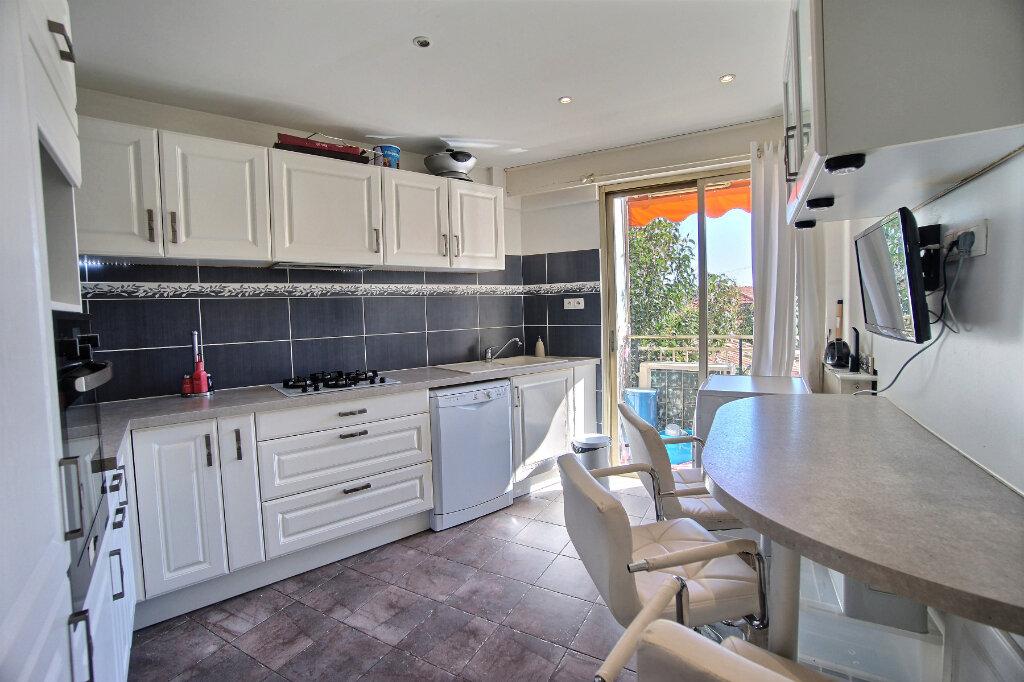 Appartement à vendre 4 101m2 à Antibes vignette-4