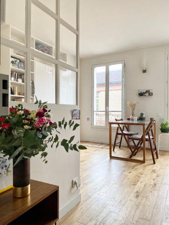 Appartement à louer 1 19.57m2 à Paris 18 vignette-1