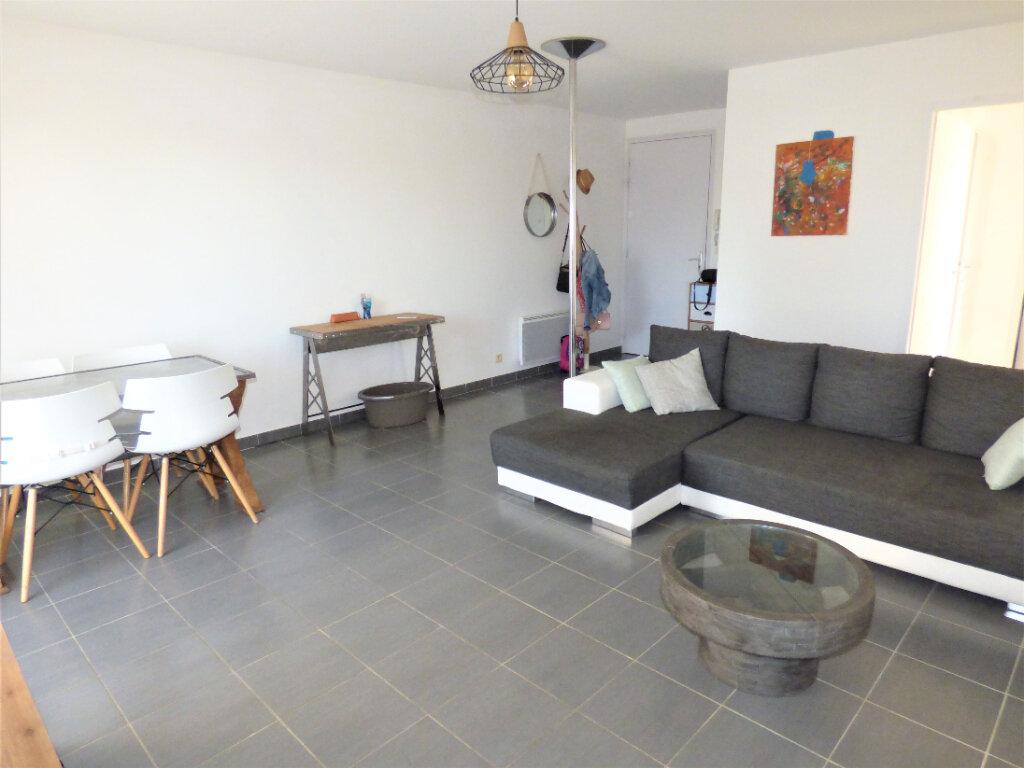 Appartement à louer 3 65m2 à Caissargues vignette-1