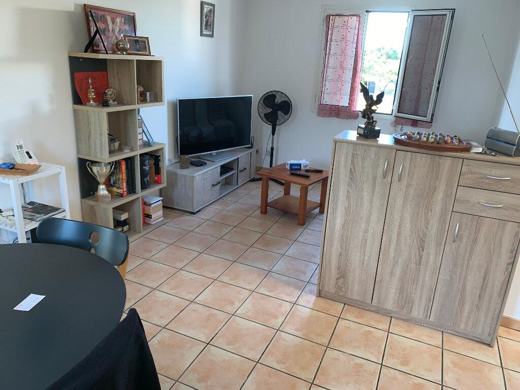 Appartement à vendre 3 60m2 à Saint-Pierre vignette-1