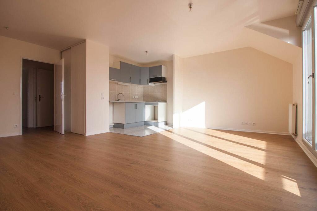 Appartement à louer 3 65.01m2 à Osny vignette-2