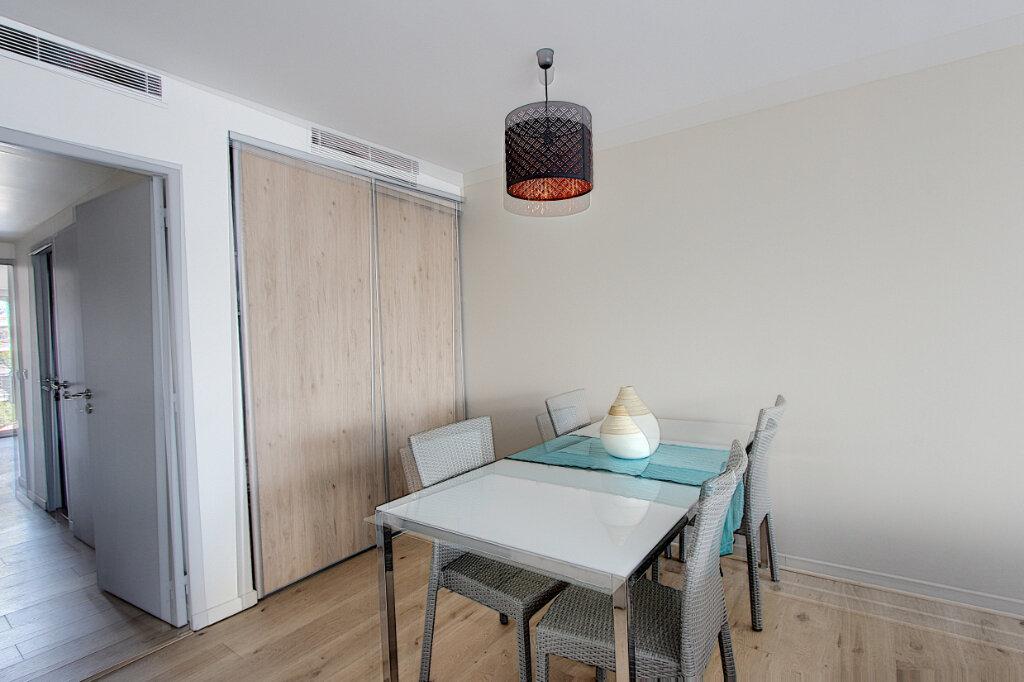 Appartement à vendre 2 60.35m2 à Juan-les-Pins - Antibes vignette-4