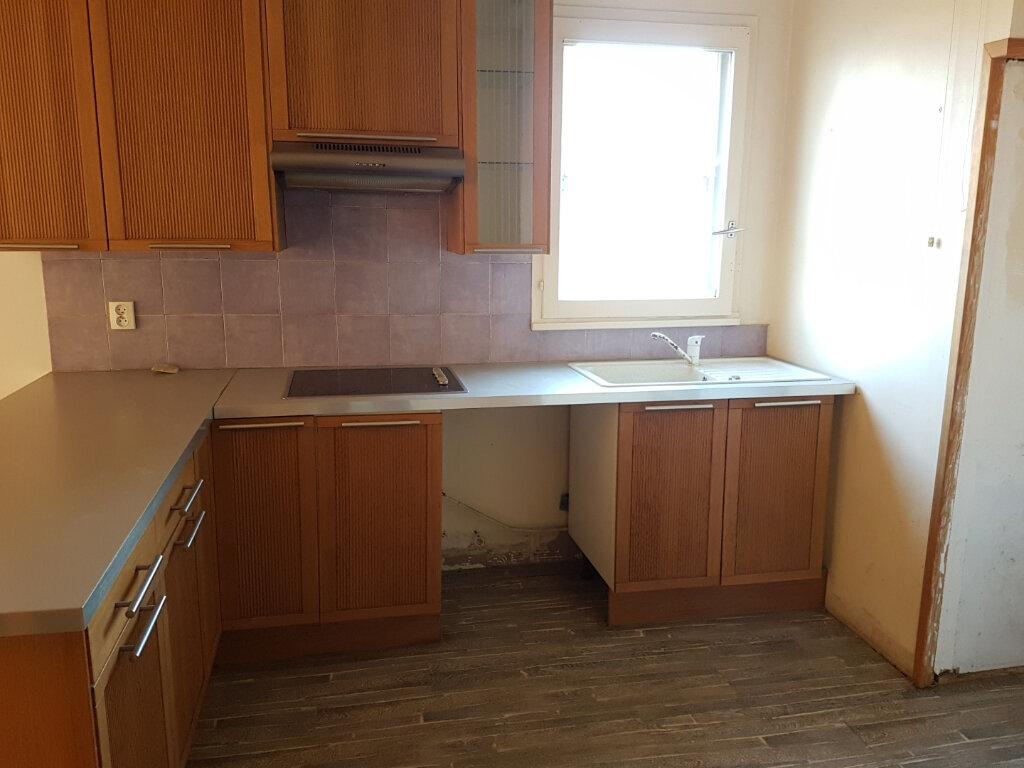 Appartement à vendre 2 56m2 à Fosses vignette-2