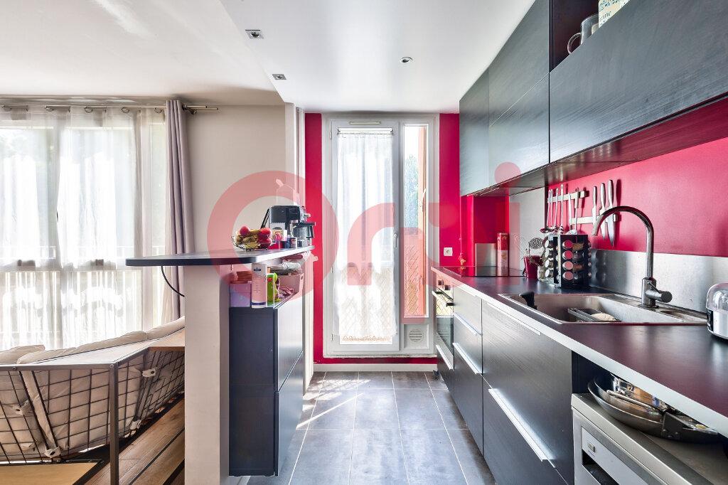 Appartement à vendre 4 69.16m2 à Villejuif vignette-4