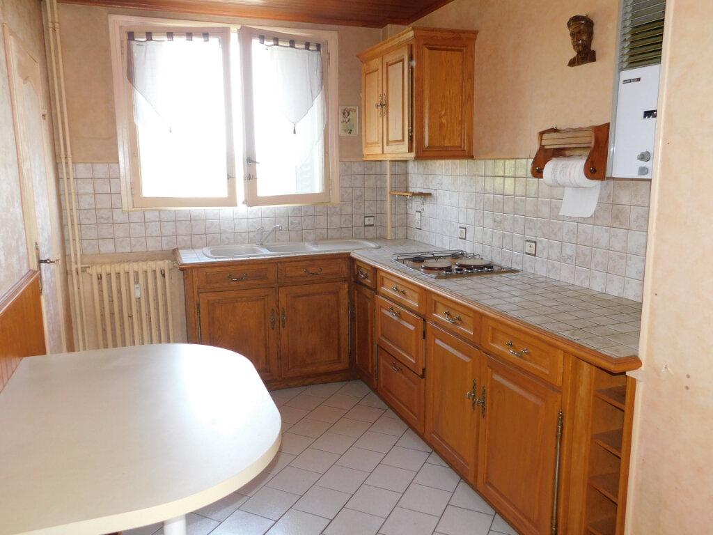 Appartement à louer 3 65.91m2 à Limoges vignette-6