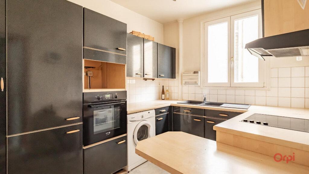 Appartement à vendre 3 69.26m2 à Paris 10 vignette-3