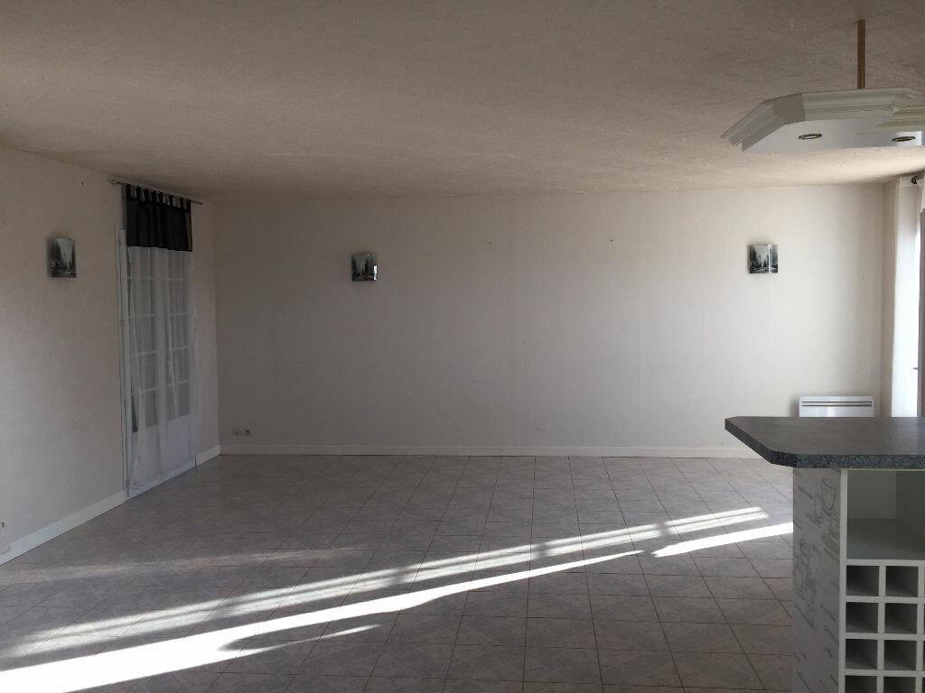 Location Maison 4 pièces à Garencières - vignette-1