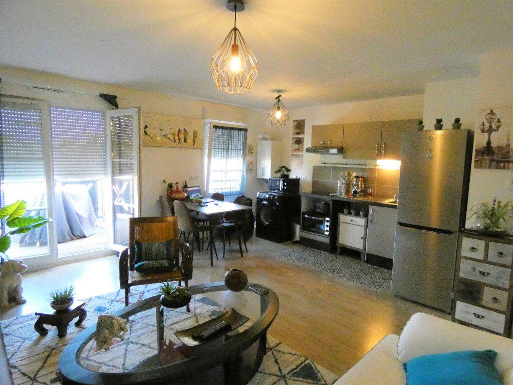 Appartement à vendre 2 51.75m2 à Champagne-sur-Oise vignette-2