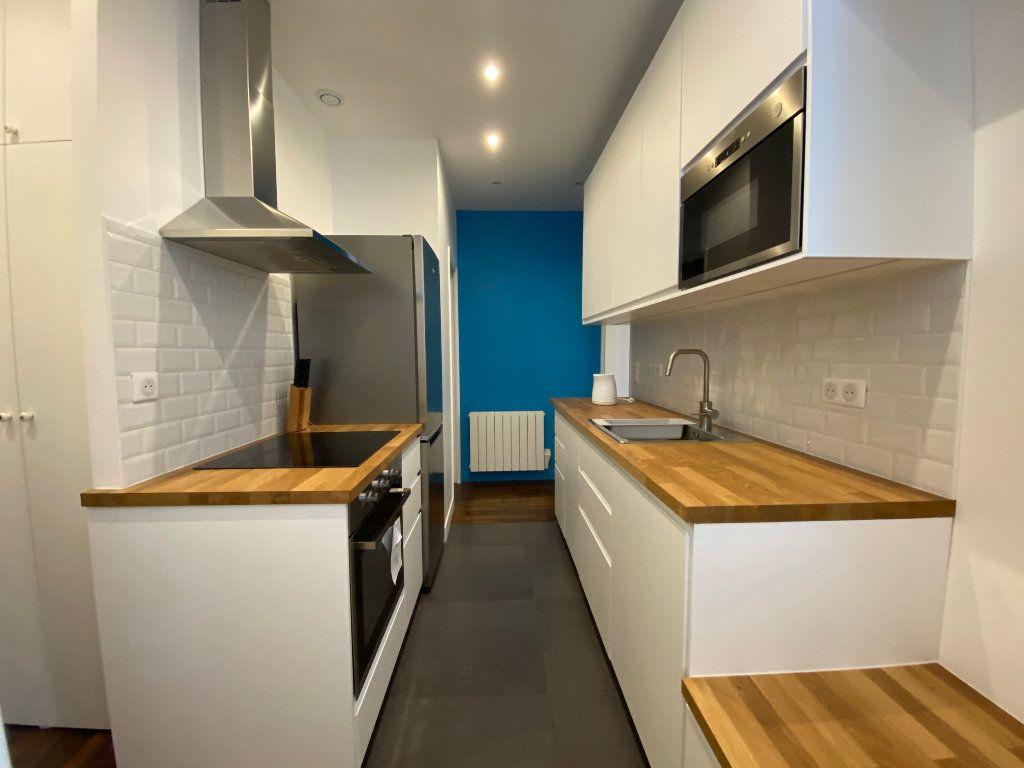 Appartement à louer 2 36.42m2 à Paris 18 vignette-6