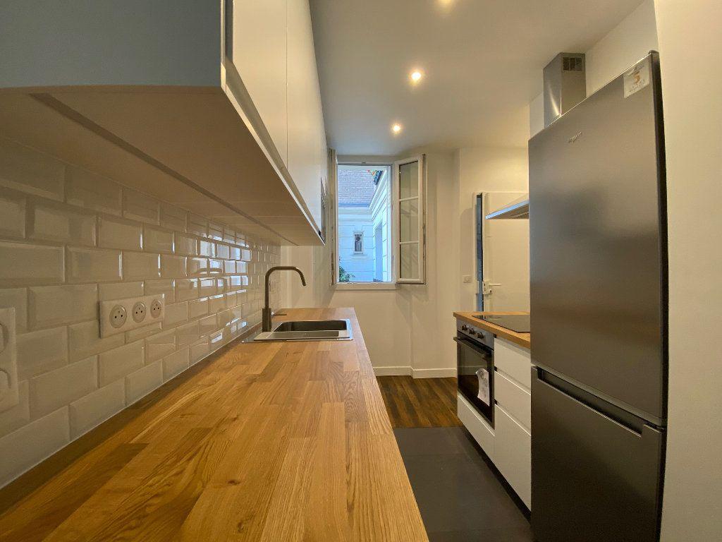 Appartement à louer 2 36.42m2 à Paris 18 vignette-8