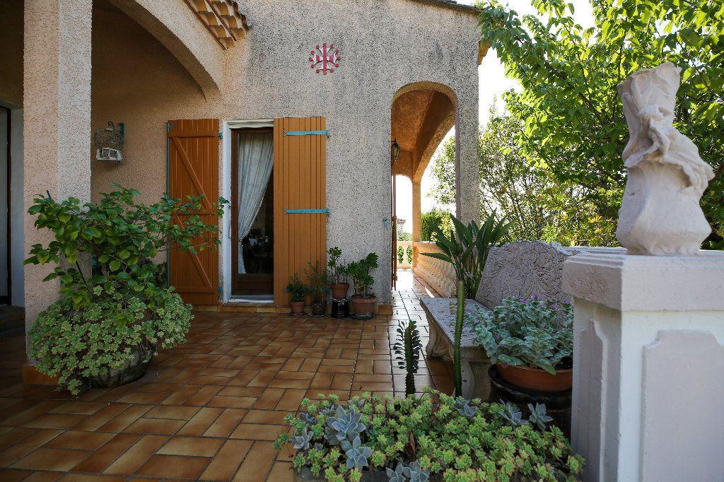 Maison à vendre 3 100.12m2 à Castelnau-de-Guers vignette-2