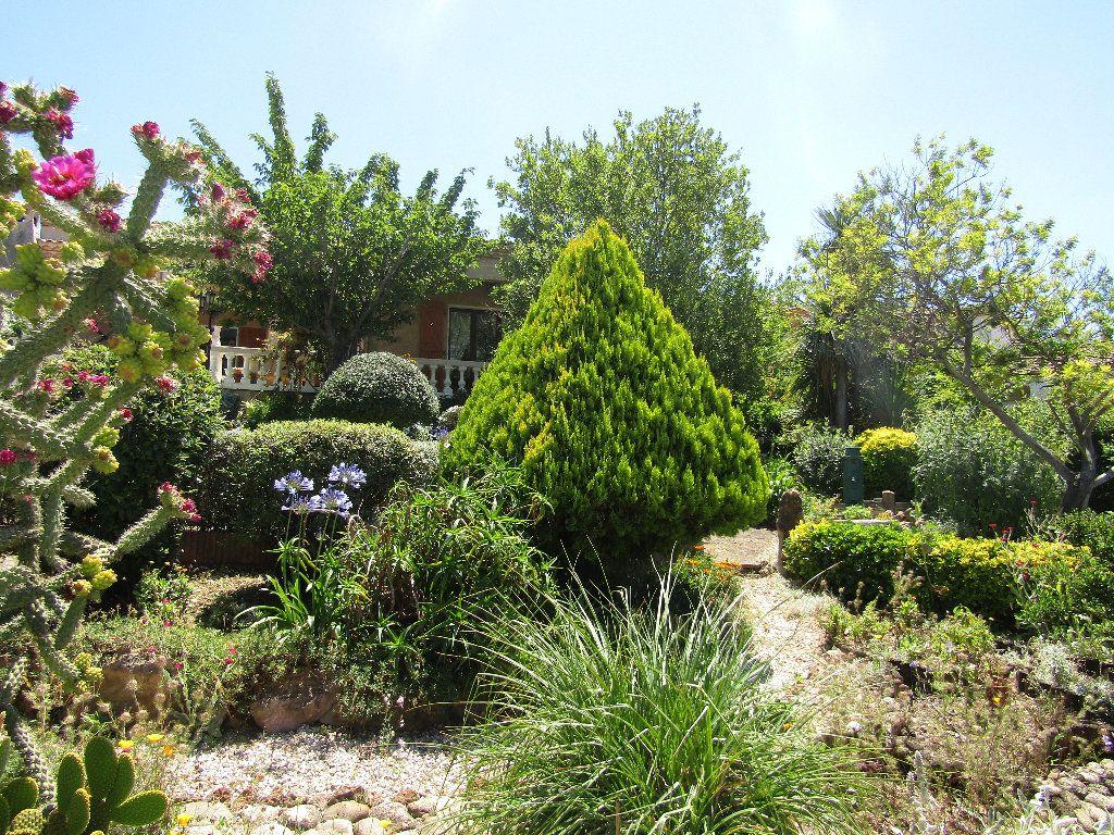 Maison à vendre 3 100.12m2 à Castelnau-de-Guers vignette-5