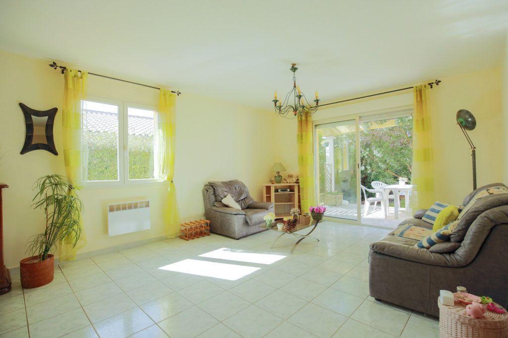 Maison à vendre 5 104.69m2 à Péret vignette-5