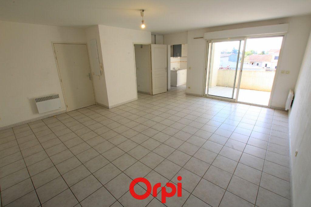 Appartement à vendre 3 65m2 à Lunel vignette-3