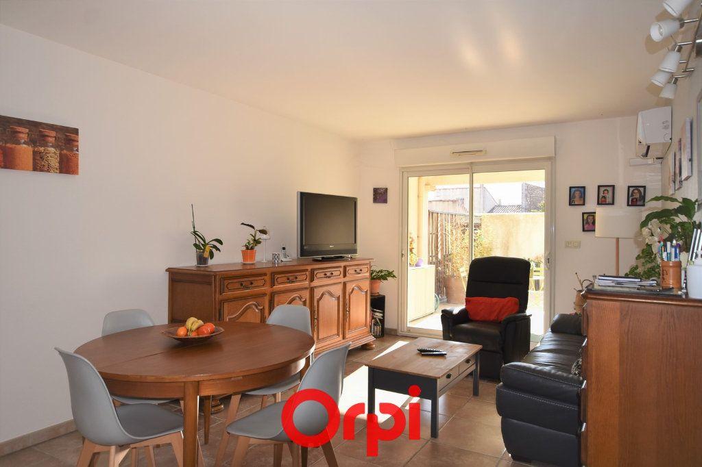 Appartement à vendre 3 57m2 à Saint-Laurent-d'Aigouze vignette-2