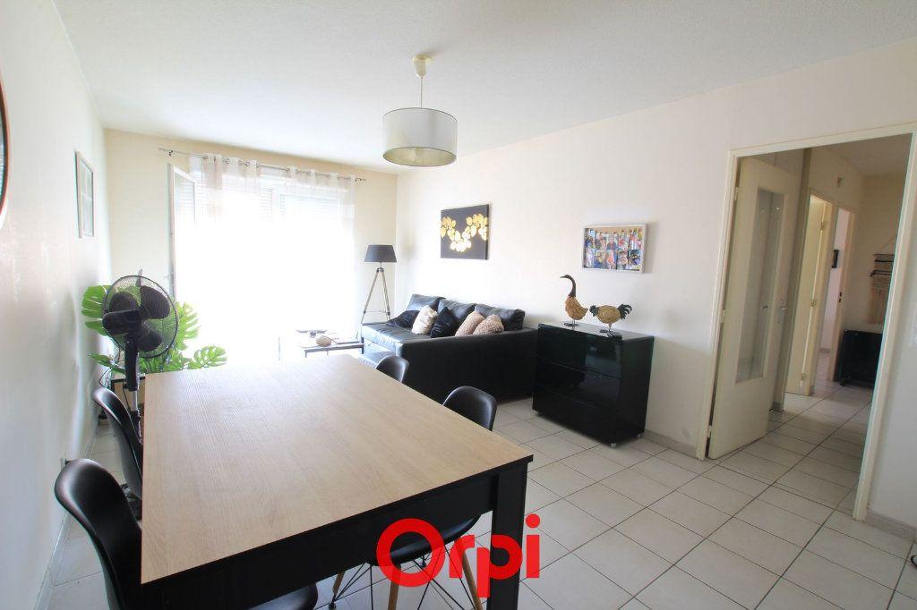 Appartement à vendre 3 63m2 à Lunel vignette-1