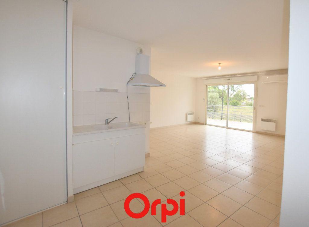 Appartement à vendre 3 65.48m2 à Aimargues vignette-2