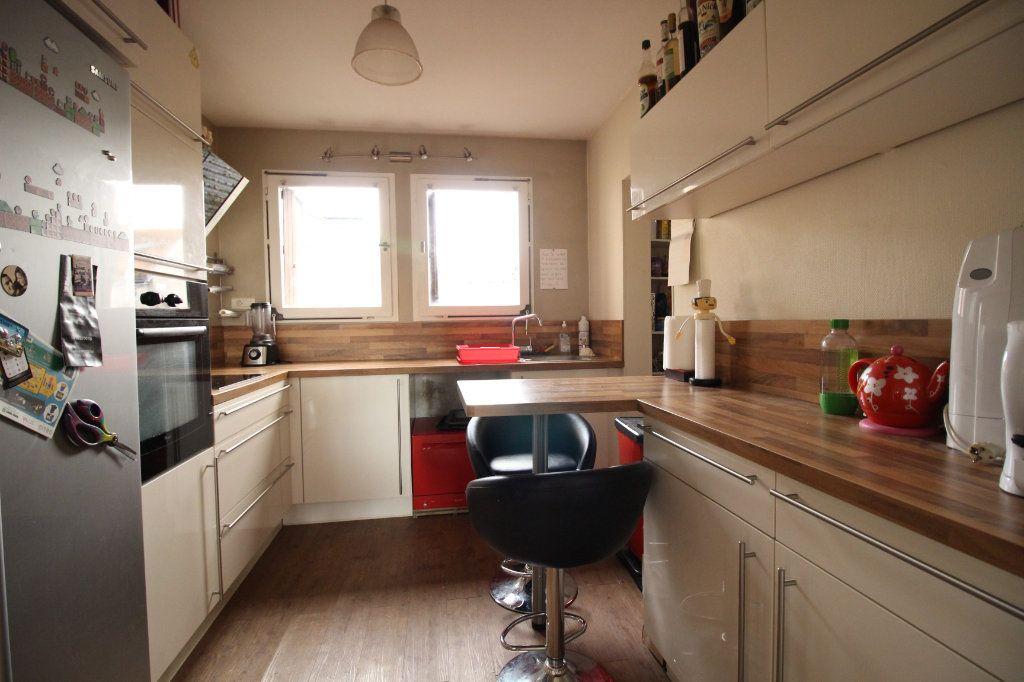 Appartement à vendre 5 97m2 à Limoges vignette-3